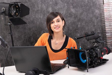 pretty young woman video editor working in studio Stock Photo