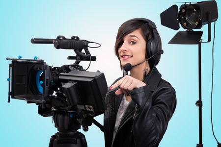 a young woman with professional video camera, DSLR