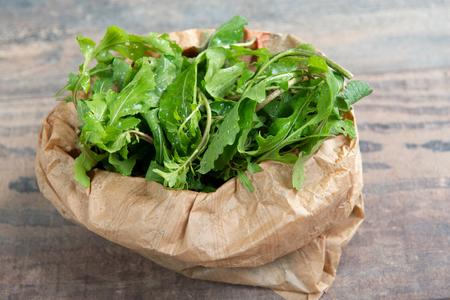 Fresh organic Arugula salad in the paper bage Stock Photo