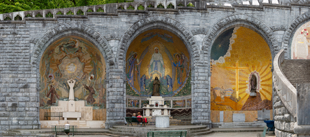 Sculpture of the Holy Mary on the outside of the Rosary Basilica of Lourdes, in France Stock Photo