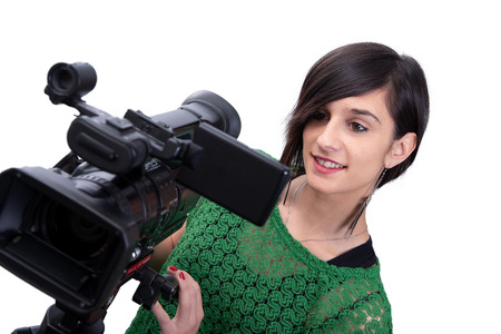 smiling young woman with professional video camcorder, on white
