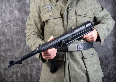 a world war two German soldier with machine gun MP 40, close-up