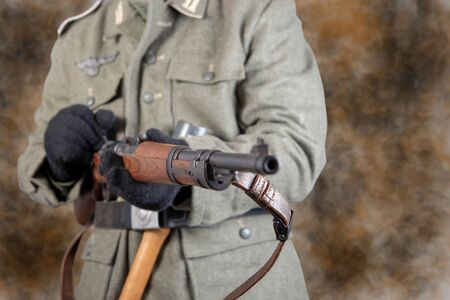WW II German soldier with a rifle and grenade Banco de Imagens