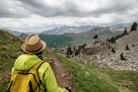 an hiker woman with view of Tena Valley in The Pyrenees, Formigal,  Huesca, Spain