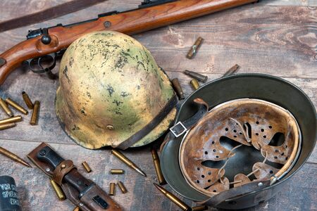 world war two german army field equipment with helmet and rifle Stock Photo