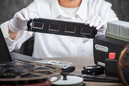 hand photographer digitize a film slide 35mm for saving Stock fotó
