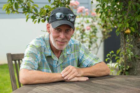 a senior man in a baseball cap portrait