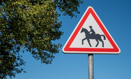 a  french road sign with horse 스톡 콘텐츠