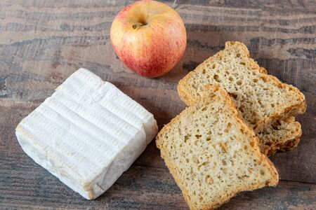 a Pont Eveque french normandy cheese with bread and apple