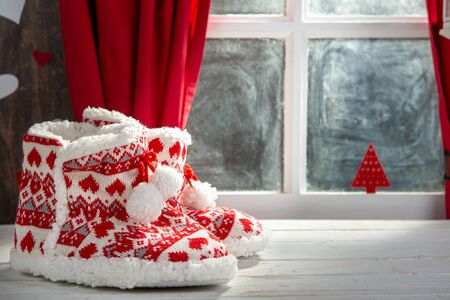 Merry Christmas concept greeting postcard with the  slipper shoes Stock Photo