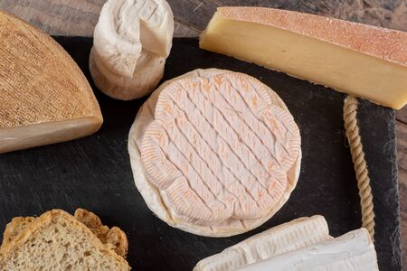 some different delicious French cheeses, dairy product