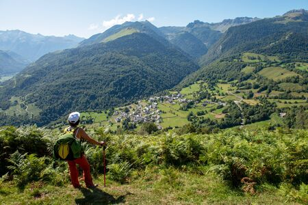 Woman hiker in the french Pyrenees mountains (plateau du Benou)