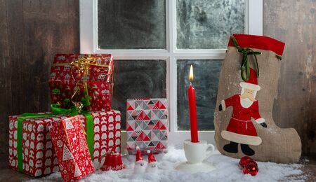 the Christmas gifts decoration near the rustic window