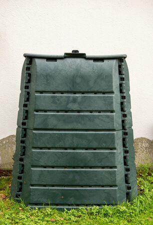 a green compost bin in the garden