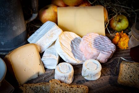 different delicious French cheeses on the rustic table Stock fotó - 136193653