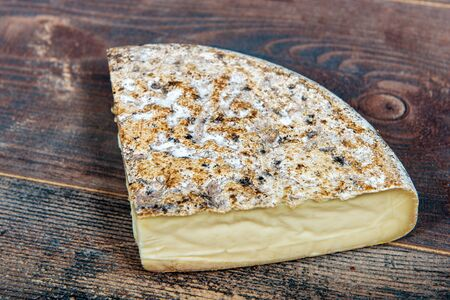 famous Tomme de Savoie, French cheese Savoy, french Alps France. Banco de Imagens