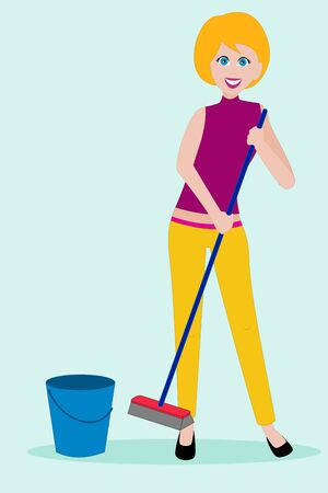 Young woman in casual clothing cleaning the floor with a broom