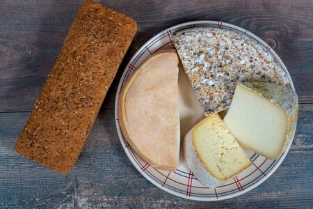 cheeses and Tomme de Savoie, the  French cheese Savoy, french Alps France.
