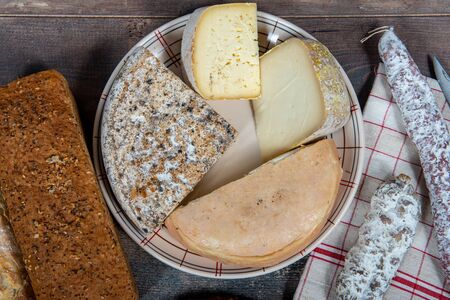 cheeses, sausage and Tomme de Savoie, French cheese Savoy, french Alps France.