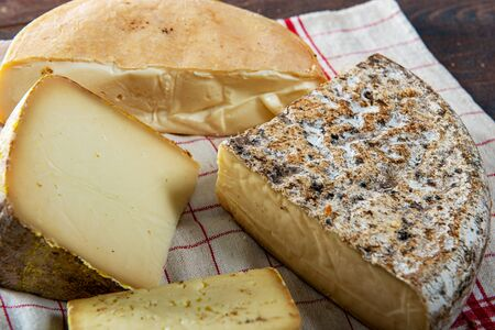 cheeses and Tomme de Savoie, French cheese Savoy, the french Alps France. Banco de Imagens