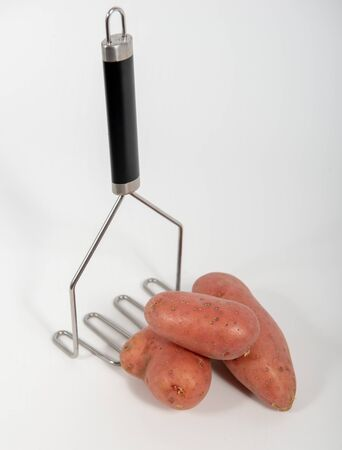 potatoes and mash press isolated on a white background