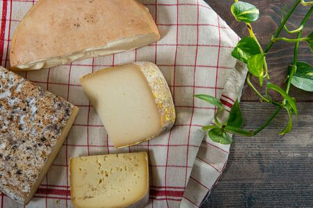 cheeses and Tomme de Savoie, French cheese Savoy,a french Alps France.