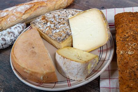 cheeses, sausage and Tomme de Savoie, Savoy, the french Alps France.
