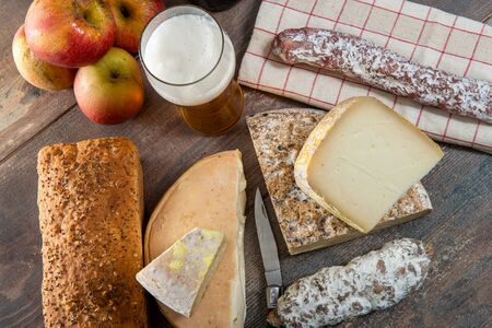 cheeses and Tomme de Savoie with beer, French cheese Savoy, the french Alps France.
