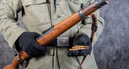 a close up of world war two German soldier with rifle