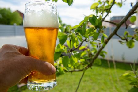 Close up of glass of beer, outdoors