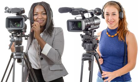 Two young women with a professional video camera and headphone Foto de archivo