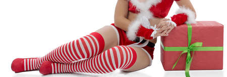 Sexy Santa woman legs isolated on the white background