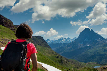 hiking woman looking at Pic du Midi Ossau in the french Pyrenees mountains 写真素材