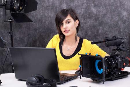 a Young woman video editor working in studio Foto de archivo