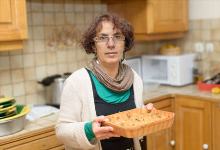 a woman makes cake in the kitchen