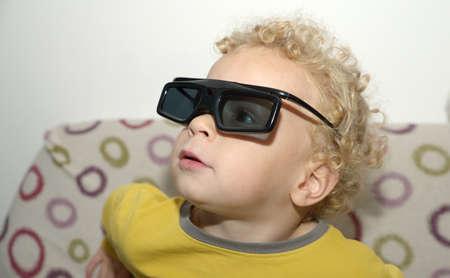 a portrait of happy preteen boy in plastic stereoscopic glasses