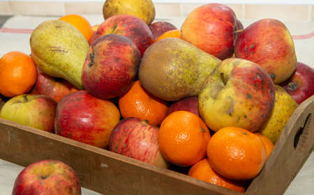 A small wooden crate with fruits Foto de archivo