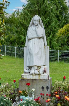 a Statue of Bernadette of Lourdes Foto de archivo