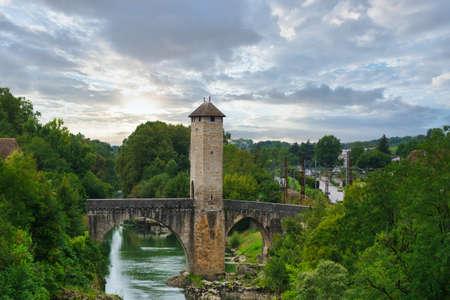 a medieval bridge over river Gave de Pau in Orthez - France