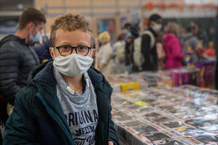 A young boy wearing a mask during the COVID-19