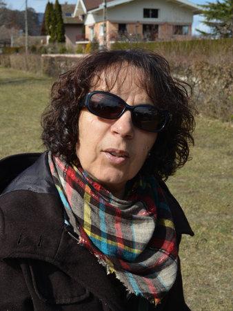 a portrait of beautiful mature brunette with sunglasses