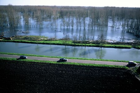 Aerial view of a road along the Sèvre Niortaise a day of flood in the marsh poitevin Stock Photo