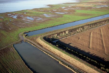 Aerial view of a dike in the Bay of Aiguillon which protects the polder