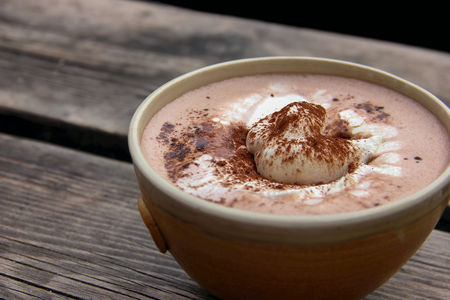 Cup of hot chocolate on an old wood plank