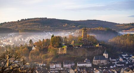 Landscape view of the old town district with the Wilhelmsturm on top of the mounatain, Dillenburg, Hesse, Germany.