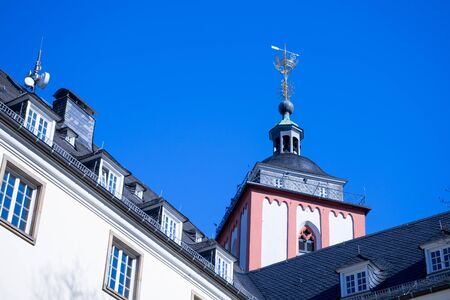 The Nikolaikirche in the city of single framed with the Rathhaus in blue sky, NRW,Germany. Foto de archivo
