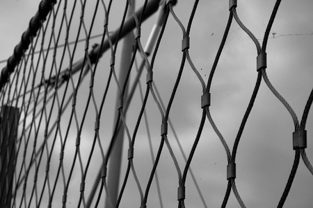 a fence with clouds in the background
