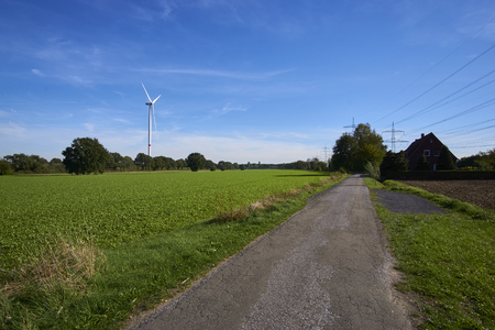 a windmill in a landscape picture Stockfoto