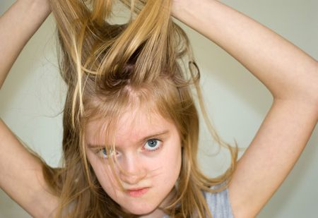 11 year old: 11 year old blond girl holding long hair up