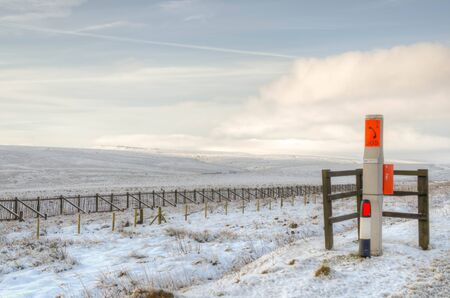moorland: Emergency post on winter moorland Stock Photo